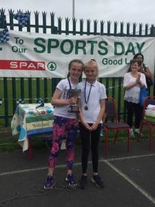 sports star of the year 2017 is presented with her trophy from last years winner.